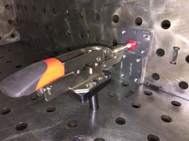 STC-IHH25 Auto Adjusting Clamp with Pedestal & Red Rubber end in action.